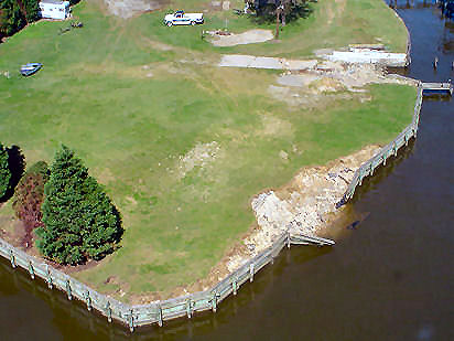 Bulkhead failure and fastland scour associated with storm surge ebb. Chesapeake Bay, BaltimoreCo. [11]