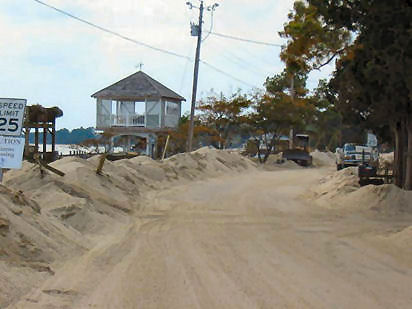 Bulldozers removed several feet of sand transported from the beach to a nearby road. Piney Pt., Potomac R., St. Mary's Co. [10]